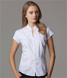Easy iron fabric Fitted style with bust, front and back darts V neck and mandarin collar Self coloured square buttons and front inner placket Shaped hem
