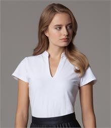 Fitted style with shaped side seams V neck and mandarin collar Self fabric faced V Taped shoulder seams Twin needle cuffs and hem