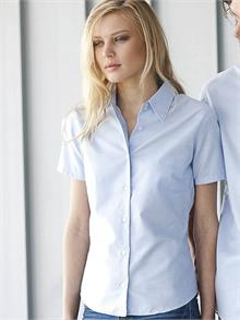 Easy care fabric Soft collar Self colour buttons Two buttons on collar band Front and back darts Shaped hem Available in long sleeve KB534