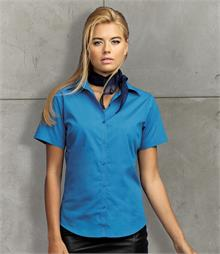 Easy care fabric Soft collar Fitted style with bust and back darts Double folded seams Light blue and white have pearlised buttons - rest have self colour buttons Curved hem Available in 3/4 sleeves, PR305 and long sleeve PR300